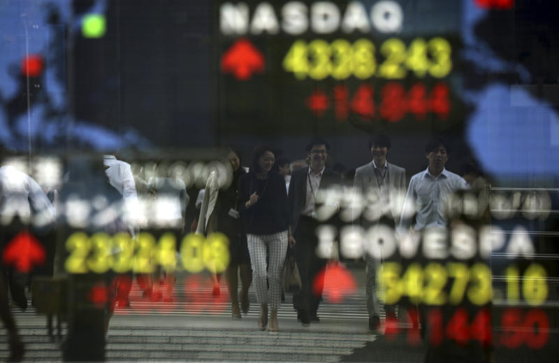 Stocks slip as World Bank cuts growth outlook