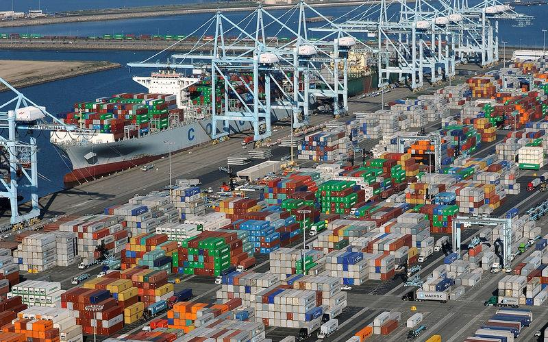 FILE PHOTO: Shipping containers sit at the ports of Los Angeles and Long Beach, California in this aerial photo taken February 6, 2015. REUTERS/Bob Riha, Jr./File Photo