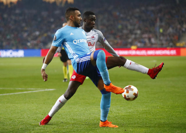 FILE - In this Thursday, May 3, 2018 file photo, Marseille's Dimitri Payet, left, and Salzburg's Diadie Samassekou challenge for the ball during the Europa League semifinal second leg soccer match between FC Salzburg and Olympique Marseille in Salzburg, Austria. Marseille will play Atletico Madrid in the Europa League final on Wednesday May 16, 2018. Dimitri Payet's probing passes from midfield, and exquisite delivery from free kicks and corners, have helped Marseille score several important goals during the knockout stages. (AP Photo/Matthias Schrader, file)
