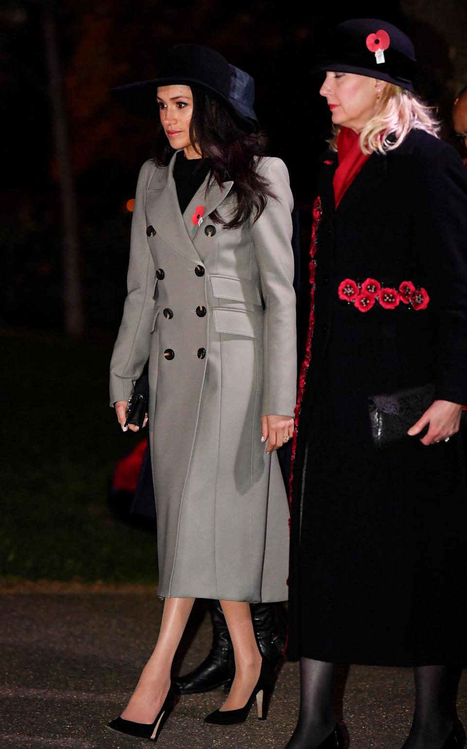 <p>Markle wore a long grey coat by Canadian designer, Smythe, for the early memorial service, as well as a wide brimmed hat. </p>