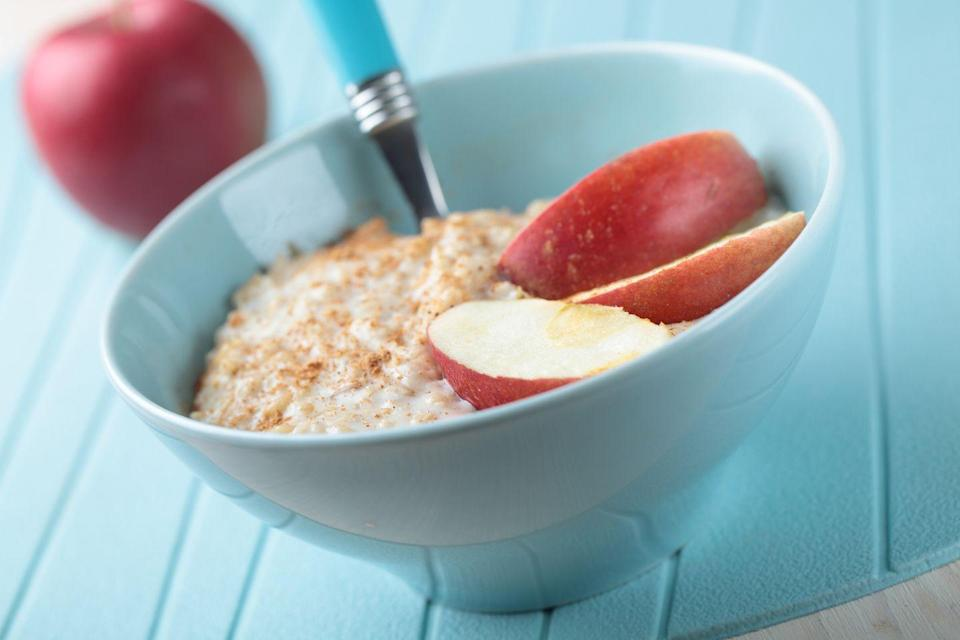 "<p>In the microwave, cook 1/2 cup quick-cooking oats with low-fat or unsweetened soy milk. Add 1/2 apple (sliced or chopped), 1 teaspoon honey, and a pinch of <a href=""https://www.goodhousekeeping.com/health/diet-nutrition/a47369/health-benefits-of-cinnamon/"" rel=""nofollow noopener"" target=""_blank"" data-ylk=""slk:cinnamon"" class=""link rapid-noclick-resp"">cinnamon</a>.</p><p><strong>RELATED: <a href=""https://www.goodhousekeeping.com/health/diet-nutrition/a31028145/oatmeal-benefits/"" rel=""nofollow noopener"" target=""_blank"" data-ylk=""slk:Is Oatmeal Healthy? All the Nutritional Facts and Benefits to Know"" class=""link rapid-noclick-resp"">Is Oatmeal Healthy? All the Nutritional Facts and Benefits to Know</a></strong></p>"