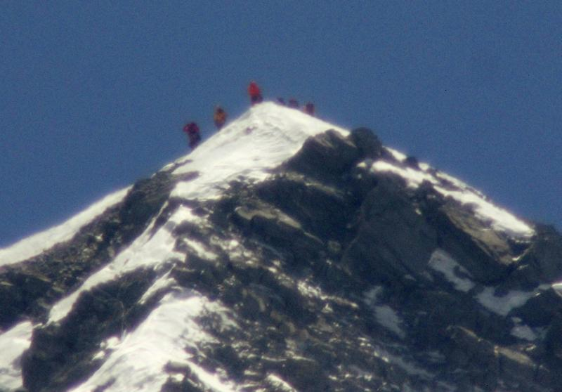 A team of climbers led by 80-year-old Japanese mountaineer Yuichiro Miura, third from left on the peak, stand on the summit of Mount Everest on Thursday, May 23, 2013. Miura on Thursday became the oldest man to reach the top of Mount Everest, a Nepali official and Miura's Tokyo-based support team said. The photo was taken with a telephoto lens from an altitude of 5,550 meters (18,208 feet). (AP Photo/Kyodo News) JAPAN OUT, MANDATORY CREDIT