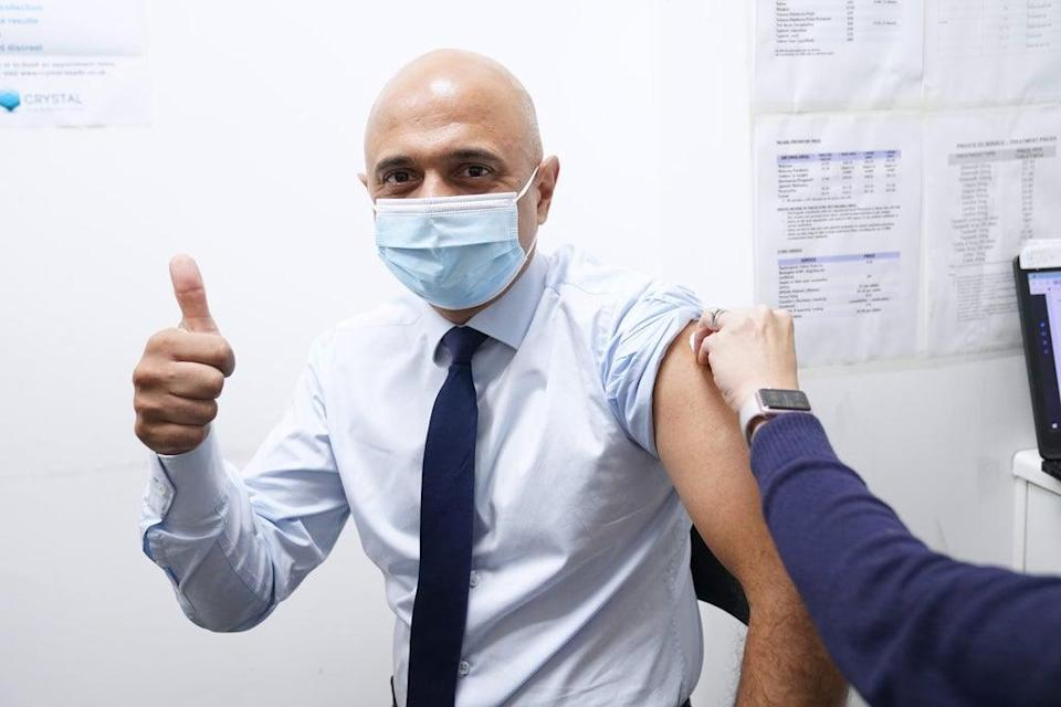 Health Secretary Sajid Javid has urged people to get their flu jab and Covid-19 booster shot (Stefan Rousseau/PA) (PA Wire)