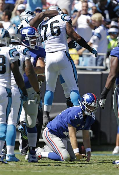 Carolina Panthers defensive end Greg Hardy (76) celebrates with teammates after sacking New York Giants quarterback Eli Manning (10) during the first half of an NFL football game in Charlotte, N.C., Sunday, Sept. 22, 2013. (AP Photo/Bob Leverone)