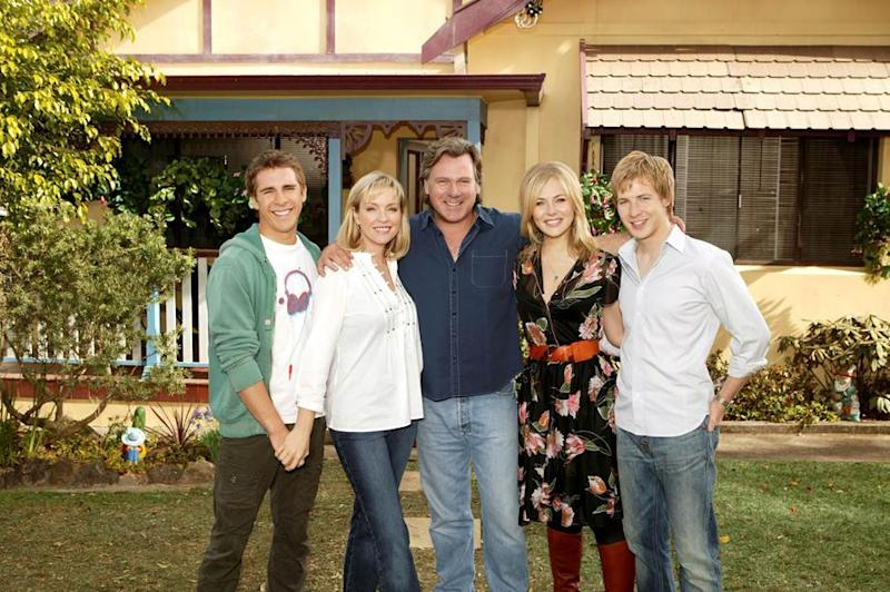 A photo of Packed To The Rafters cast members Rebecca Gibney (Julie Rafter), Erik Thomson (Dave Rafter), Jessica Marais (Rachel Rafter), Hugh Sheridan (Ben Rafter), Angus McLaren (Nathan Rafter)