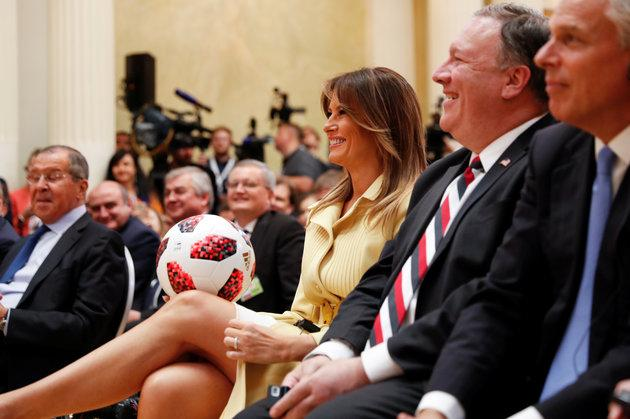 First Lady Melania Trump smiles as she holds a football thrown to her by US President Donald Trump during his joint news conference with Russia's President Vladimir Putin.