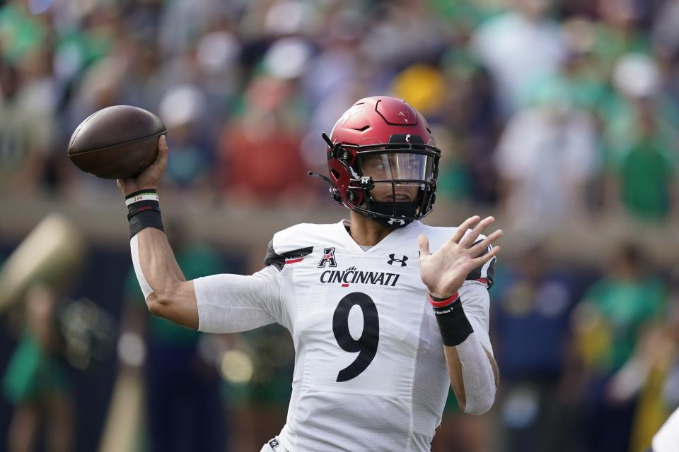 Cincinnati quarterback Desmond Ridder (9) throws during the first half of an NCAA college football game against Notre Dame, Saturday, Oct. 2, 2021, in South Bend, Ind. (AP Photo/Darron Cummings)
