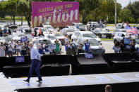 Democratic presidential candidate former Vice President Joe Biden removes his jacket as he arrives to peak at a drive-in rally at Broward College, Thursday, Oct. 29, 2020, in Coconut Creek, Fla. (AP Photo/Andrew Harnik)