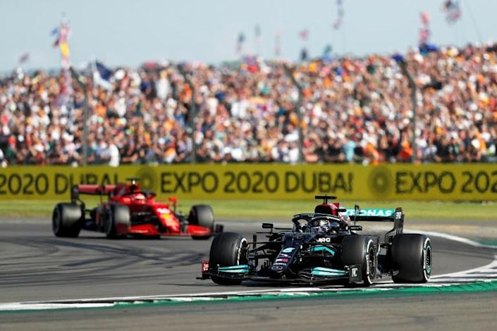 Final twist: Lewis Hamilton passed Charles Leclerc with two laps to go at Silverstone