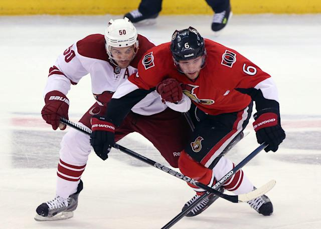 Ottawa Senators' Bobby Ryan (6) is checked by Phoenix Coyotes' Antione Vermette (50) during the first period of an NHL hockey game Saturday, Dec. 21, 2013, in Ottawa, Ontario. (AP Photo/The Canadian Press, Fred Chartrand)