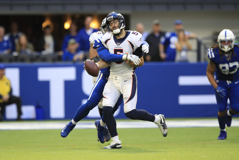 Joe Flacco is sacked in a loss to the Colts. (Getty Images)