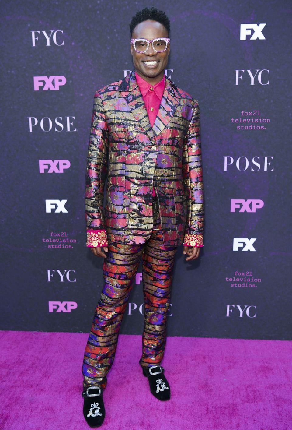 <p>Porter at a <em>Pose</em> event in a pink shirt and suit with a painterly floral print. </p>