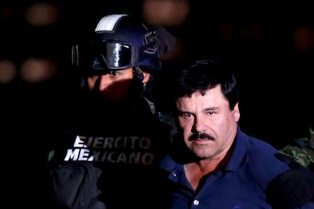 "FILE PHOTO: Joaquin ""El Chapo"" Guzman is escorted by soldiers during a presentation at the hangar belonging to the office of the Attorney's General in Mexico City"
