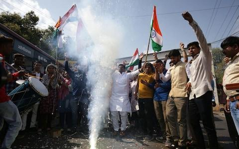 Indian residents let off fireworks to celebrate the Indian Air Force (IAF) strike launched on a Jaish-e-Mohammad (JeM) camp at Balakot, in Bhopal in the Madhya Pradesh state on February 26, 2019. - Credit: AFP