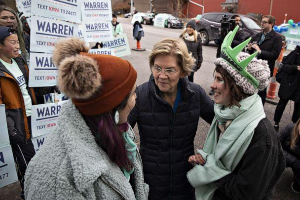 PHOTO: Senator Elizabeth Warren, a Democrat from Massachusetts and 2020 presidential candidate, center, greets supporters outside Wells Fargo Arena ahead of the Iowa Democratic Party Liberty & Justice Dinner in Des Moines, Iowa, U.S. (Daniel Acker/Bloomberg via Getty Images)