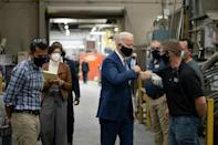 Biden's campaigning was scaled down in 2020, and he traded loud and crowded rallies for smaller affairs, like this tour of an aluminum plant in Wisconsin