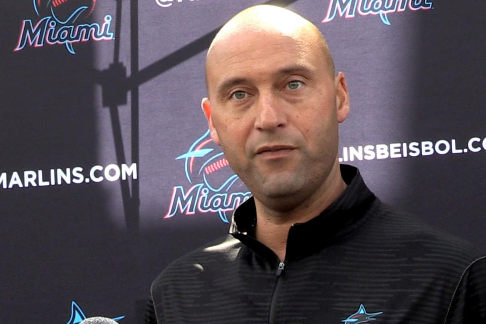 FILE - In this Feb. 24, 2020, file photo, Miami Marlins CEO Derek Jeter talks to the media before the team plays the St. Louis Cardinals in a baseball game in Jupiter, Fla. Jeter blames the team's coronavirus outbreak on a collective false sense of security that made players lax about social distancing and wearing masks. Infected were 21 members of the team's traveling party, including at least 18 players. (Charles Trainor Jr./Miami Herald via AP, File)