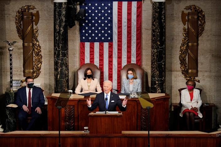 President Joe Biden addresses a joint session of Congress attended by Vice President Kamala Harris and Speaker of the House Nancy Pelosi  in the House chamber of the U.S. Capitol on April 28.