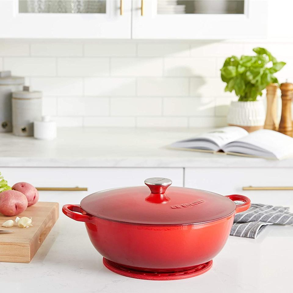 """Yes, you can get <a href=""""https://amzn.to/33Y4xvb"""" target=""""_blank"""" rel=""""noopener noreferrer"""">Le Creuset's colorful cookware</a>at Amazon, too. This is definitely a Prime Day deal worth knowing about. This enameled chef's oven can keep heat in and it comes with a matching trivet that'll be helpful when you serve dinner.<a href=""""https://amzn.to/3nSw5Kc"""" target=""""_blank"""" rel=""""noopener noreferrer"""">Originally $316, get it now for $180 at Amazon</a>."""