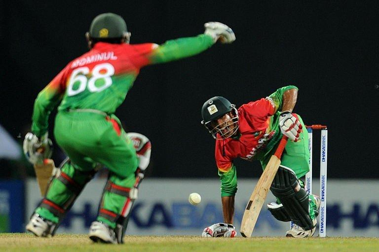 Bangladesh cricketer Nasir Hossain (R) plays a shot in Pallekele on March 28, 2013