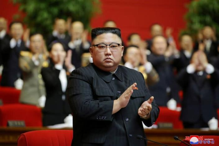 North Korean leader Kim Jong Un applauds at the 8th Congress of the Workers' Party in Pyongyang