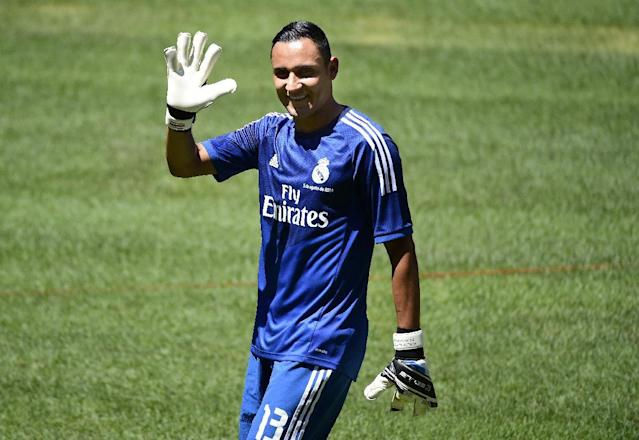Costa Rican goalkeeper Keylor Navas poses before a press conference for his official presentation following his signing with Spanish club Real Madrid in Madrid on August 5, 2014 (AFP Photo/Gerard Julien)