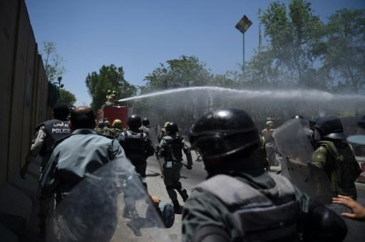 Gunshots as Kabul protesters clash with police over truck bomb
