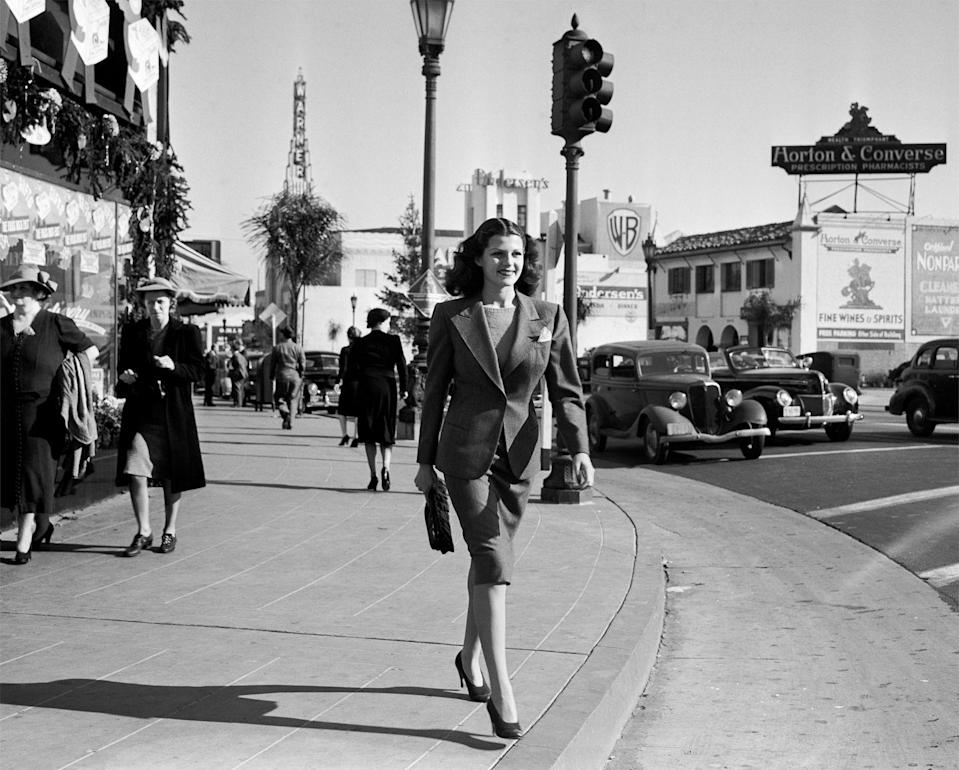 """<p>An Old Hollywood icon, entertainer Rita Hayworth cruised down the street near Warner Bros. Studio in LA. At the time, she was married to Edward C. Judson, but that was her first of five marriages. </p><p><strong>RELATED: </strong><a href=""""https://www.goodhousekeeping.com/beauty/hair/g3471/most-popular-hairstyles-of-all-time/"""" rel=""""nofollow noopener"""" target=""""_blank"""" data-ylk=""""slk:The Trendiest Hairstyle the Year You Were Born"""" class=""""link rapid-noclick-resp"""">The Trendiest Hairstyle the Year You Were Born</a></p>"""