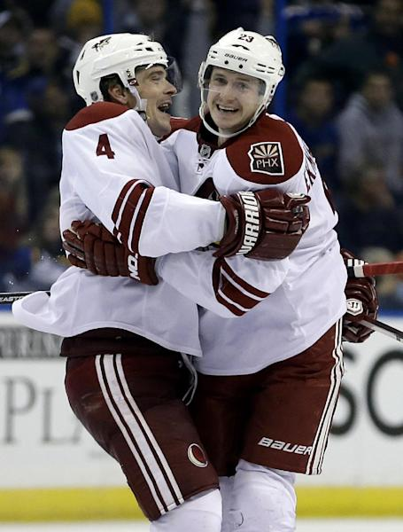 Phoenix Coyotes' Oliver Ekman-Larsson, right, of Sweden, is congratulated by Zbynek Michalek, of Czech Republic, after scoring the game-winning goal during overtime of an NHL hockey game against the St. Louis Blues Tuesday, Nov. 12, 2013, in St. Louis. The Coyotes won 3-2. (AP Photo/Jeff Roberson)