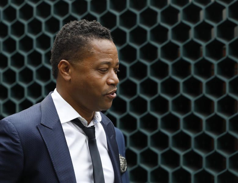 Actor Cuba Gooding Jr., left, is lead by a police officer from New York's Special Victim's Unit, Thursday, June 13, 2019. He faces allegations he groped a woman at a city night spot. A 29-year-old woman told police the 51-year-old Gooding grabbed her breast while he was intoxicated around 11:15 p.m. Sunday. Gooding denies the allegations. (AP Photo/Mark Lennihan)
