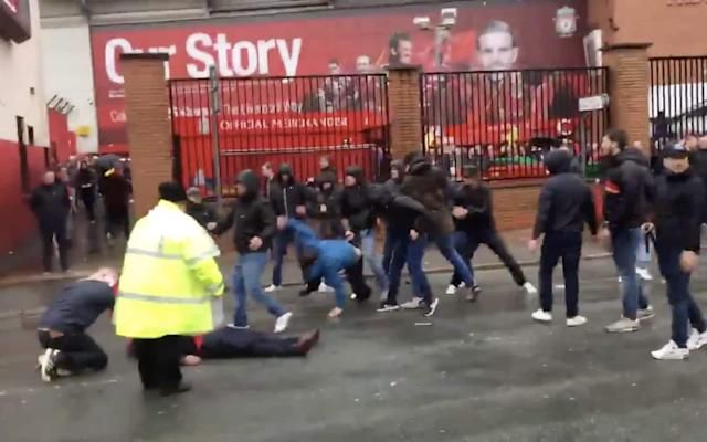 "Liverpool's Champions League semi-final meeting with AS Roma was marred by violent scenes outside Anfield as at least one man was severely injured after the two sets of fans clashed in the shadow of the Kop. Footage posted on social media showed groups of Roma fans charging towards Liverpool supporters, one of whom had been knocked to the ground, before they were chased down the streets behind the stadium. A middle-aged Liverpool fan was treated on the road by a team of paramedics as police waited to usher ambulances through the packed roads in the minutes before the game kicked off. Merseyside Police said it was investigating a serious assault which took place outside the stadium 10 minutes before the match kicked off. In a video shared on Twitter, a collection of around 20 Roma fans were filmed attacking a Liverpool fan while the injured man was attended to by a steward. According to eyewitness reports, the fans charged using batons and belts as weapons, before fleeing after Liverpool fans in the vicinity became aware of the situation. The road was soon flooded with police officers who cleared the area around the injured man as he received treatment. He was eventually carried inside an ambulance on a stretcher, with stewards and police frantically trying to clear the roads of fans to allow the vehicle to leave the area. Unpleasant scenes outside Anfield a few mins ago, one L'pool fan injured pic.twitter.com/II9r9QZuL6— Dan Roan (@danroan) April 24, 2018 ""We are investigating a serious assault of a man outside the Albert pub on Walton Breck Road at about 7.35pm,"" Merseyside Police said in a statement which also appealed for information. Roma fans have just attacked Liverpool supporters with belts, outside the Albert. About 20. One guy down getting treatment— Jonathan Northcroft (@JNorthcroft) April 24, 2018 There were also separate reports of scuffles between the two sets of fans outside of a local pub in the area in further ugly scenes that will raise concerns about Liverpool's trip to play Roma in the second leg next month. The violence followed hours of frenzied build-up to the game in the roads near Anfield as the home fans once again gathered to welcome the Liverpool team bus and set off flares. Liverpool versus AS Roma; mounted police emerge from the smoke flares Credit: ACTION PLUS The incidents come after the events outside of Anfield ahead of Liverpool's quarter-final first leg against Manchester City earlier this month, when the City team bus was damaged by objects thrown by supporters waiting on the streets outside of the stadium. Liverpool were charged by UEFA following the damage to the City bus, and this week the club released a video in which manager Jurgen Klopp pleaded with supporters to ""show our best to the world"". liverpool roma grid He said: ""In the stadium, do it again and better. Outside the stadium, please show the respect we have to show. We can show how wonderful Liverpool people are and we can show it in 20 minutes before the game and then the whole world knows it."" Many Liverpool fans set off red smoke-bombs as they mounted police vans and signs as they waited to greet the Liverpool bus once again, but these were largely scenes of celebration and excited expectation rather than violence. The welcoming of the Liverpool team bus is a relatively new development for the supporters of the club, who first started lining the streets with flags and banners during the 2013/14 season when the club came so close to the Premier League title under Brendan Rodgers. Unlike against Manchester City, there was no sign of any trouble or violence as the team buses arrived at the stadium. The violence appeared to begin with the incident involving the group of Roma fans who charged towards Liverpool fans just metres from the entrance to the Kop. Before the game, Merseyside Police had warned fans that it would crack down on any fan disturbances around the ground, saying its policing style would be ""firm, fair and friendly"" and vowing to take action against any individuals who caused problems. Chief superintendent Dave Charnock said on Monday: ""We are expecting a vibrant atmosphere at Tuesday's match, but our intention is that at the end of day we will be talking about the game and what happened on the pitch as opposed to off the pitch. ""Our policing style will be firm, fair and friendly, but we will take action where necessary against those individuals who may seek to cause problems or misbehave and spoil the evening for the majority of supporters."""