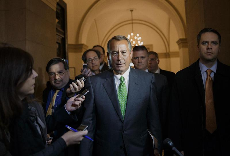 House Speaker John Boehner of Ohio is surrounded by reporters as he returns to the Capitol in Washington, Tuesday, Feb. 25, 2014, following a meeting at the White House with President Barack Obama. (AP Photo/J. Scott Applewhite)