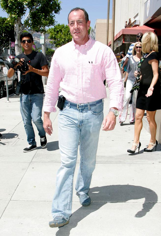 "Speaking of eyesores, Lindsay's dysfunctional father Michael is in desperate need of a makeover. High-waisted mom jeans + a cell phone belt clip + suede loafers = fashion faux pas. Gustavo Munoz/BuzzFoto/<a href=""http://www.wireimage.com"" target=""new"">WireImage.com</a> - May 4, 2010"