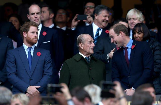 Harry, the Duke of Edinburgh and the Duke of Cambridge during the Rugby World Cup Final at Twickenham in London (David Davies/PA)