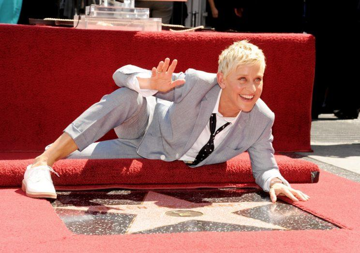 Ellen DeGeneres posing with her star on the Hollywood Walk of Fame. Her tweet on Bell Let's Talk day generated more than $14,000 for the campaign. Photo from Getty Images