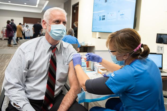 Northwestern Medicine Lake Forest Hospital Chief Medical Officer Dr. Jeffrey Kopin receives the Pfizer-BioNTech vaccine Thursday in Lake Forest. (Northwestern Medicine)