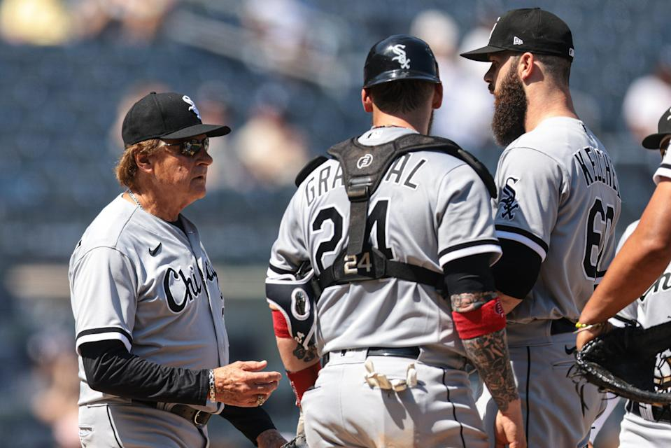 White Sox manager Tony La Russa takes the ball from starting pitcher Dallas Keuchel.