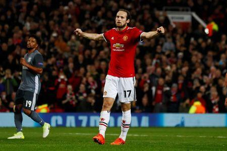 Soccer Football - Champions League - Manchester United vs S.L. Benfica - Old Trafford, Manchester, Britain - October 31, 2017 Manchester United's Daley Blind celebrates scoring their second goal from the penalty spot Action Images via Reuters/Jason Cairnduff