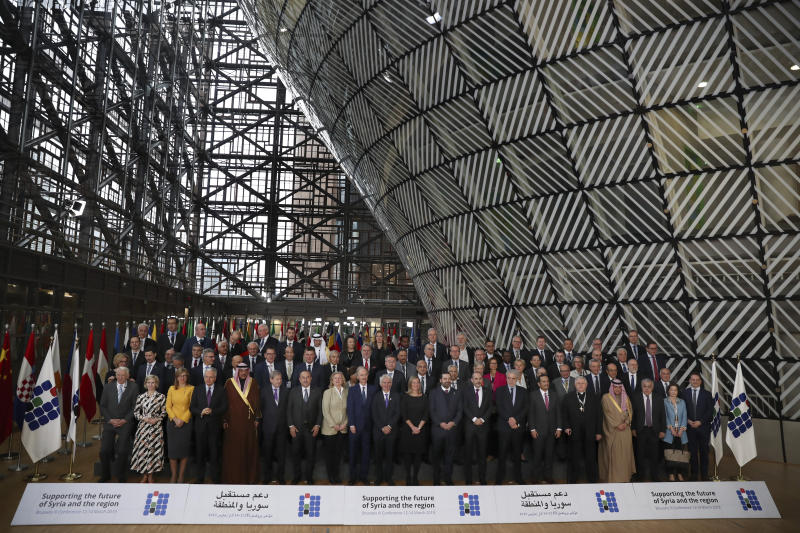 Officials pose for a group photo during a Syria donors conference at the European Council headquarters in Brussels, Thursday, March 14, 2019. Senior representatives from scores of countries and international organizations gathered Thursday in a fresh effort to drum up aid for Syria amid growing donor fatigue as the conflict enters its ninth year. (AP Photo/Francisco Seco)
