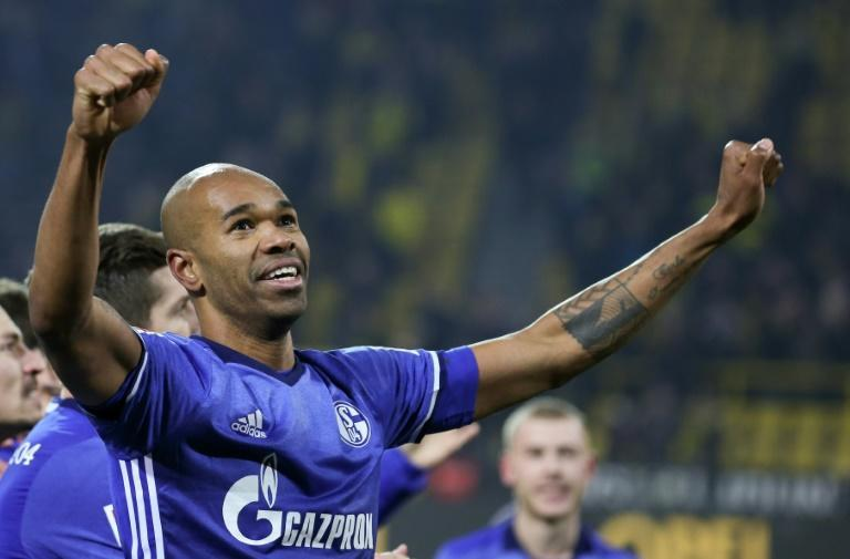Brazil defender Naldo, now Schalke's assistant coach, celebrates scoring the last-gasp equaliser to seal a 4-4 draw at Dortmund in 2017.