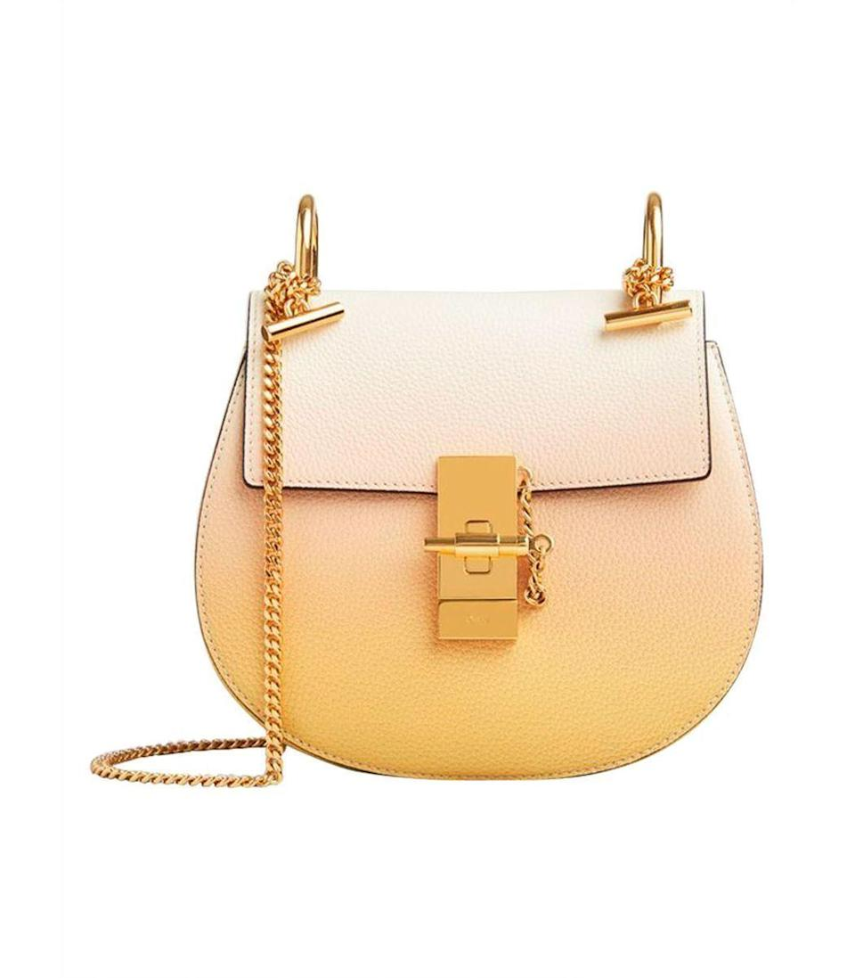 """<p><strong>Chloé</strong></p><p>ShopBAZAAR.com</p><p><strong>$1890.00</strong></p><p><a href=""""https://go.redirectingat.com?id=74968X1596630&url=https%3A%2F%2Fshop.harpersbazaar.com%2Fdesigners%2Fchlo%2Fdegrade-mini-drew-shoulder-bag-61887.html&sref=https%3A%2F%2Fwww.harpersbazaar.com%2Ffashion%2Ftrends%2Fg35048473%2Fbags-for-2021%2F"""" rel=""""nofollow noopener"""" target=""""_blank"""" data-ylk=""""slk:Shop Now"""" class=""""link rapid-noclick-resp"""">Shop Now</a></p><p>Designed after our forever muse, the perfect sunset, this is a bag worth holding onto in 2021. We're calling it the perfect vacation bag to inspire our future travels.</p>"""