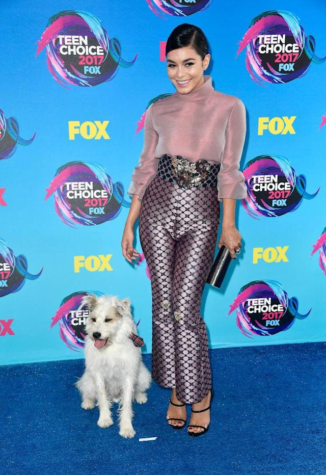 <p>The queen of Coachella has the best accessory of the night! Hudgens paired her high-waist pants and sheer top with a dog named Happy. (Photo: Getty Images) </p>
