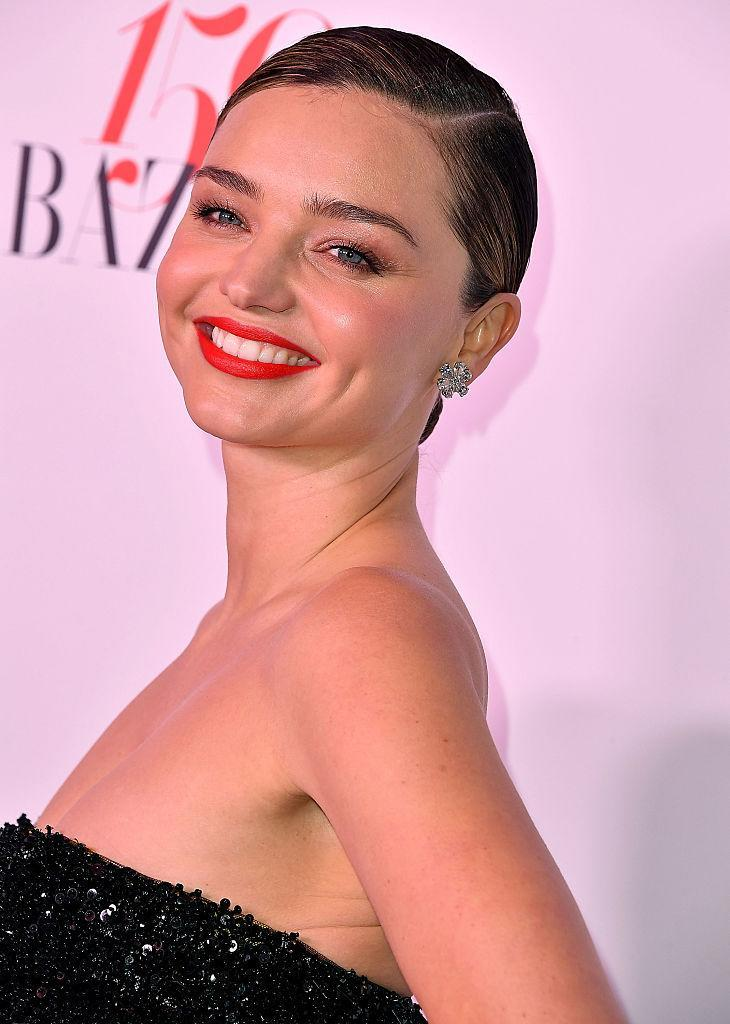 Miranda Kerr arrives at the Harper's Bazaar Celebrates 150 Most Fashionable Women event, which was sponsored by TUMI, American Express, La Perla, and Hearts on Fire. (Photo: Getty Images)