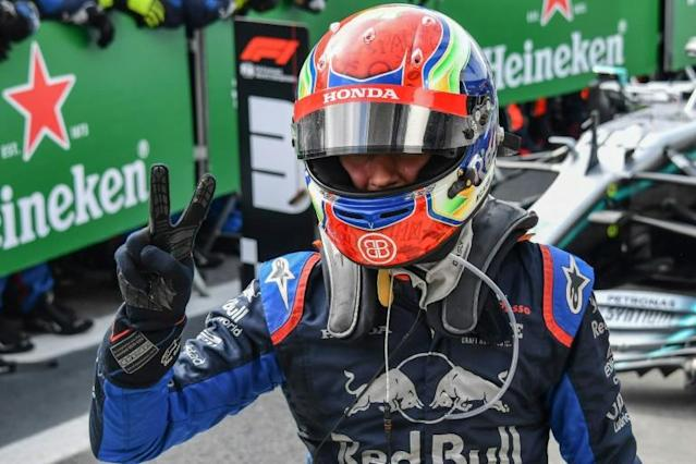 Reality star: Pierre Gasly celebrates his second place at the Brazilian Grand Prix last November (AFP Photo/NELSON ALMEIDA)