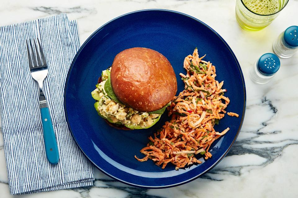 "Our vegetarian play on the classic chicken salad swaps in creamy, protein-packed chickpeas. With feta, cucumber, avocado, and spinach, this sandwich (along with the crunchy slaw) makes a satisfying and <a href=""https://www.epicurious.com/recipes-menus/favorite-fast-easy-dinners-22-minute-meals-recipes-gallery?mbid=synd_yahoo_rss"" rel=""nofollow noopener"" target=""_blank"" data-ylk=""slk:quick weeknight dinner"" class=""link rapid-noclick-resp"">quick weeknight dinner</a>. <a href=""https://www.epicurious.com/recipes/food/views/chickpea-salad-sandwich-with-creamy-carrot-radish-slaw?mbid=synd_yahoo_rss"" rel=""nofollow noopener"" target=""_blank"" data-ylk=""slk:See recipe."" class=""link rapid-noclick-resp"">See recipe.</a>"