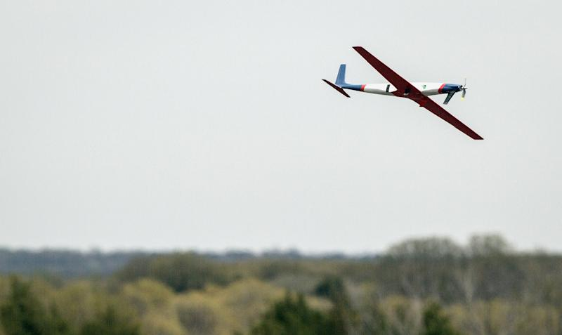 In this April 2013 photo provided by Oklahoma State University, Team Black's airplane takes off during SpeedFest III, in Stillwater, Okla. Researchers at Oklahoma State University are designing and building sleek, Kevlar-reinforced unmanned aircraft _commonly known as drones_ to fly into the nation's worst storms and send back real-time data to first responders and forecasters about how fierce they might become. (AP Photo/ Oklahoma State University, Gary Lawson)