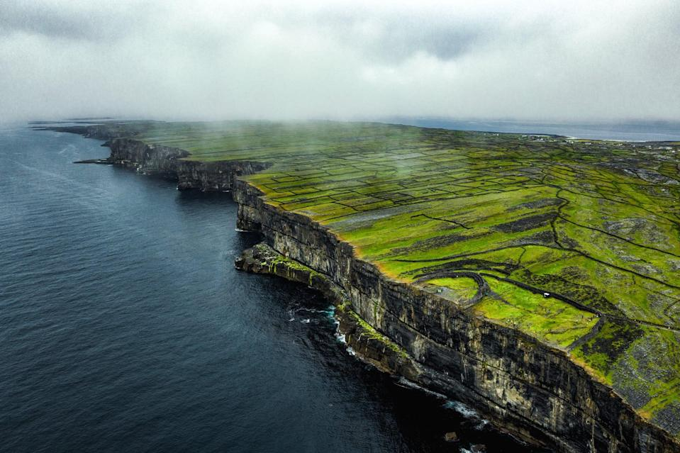 """<p>If the weather permits, you have to take a day trip out to Inishmore (or Inis Mór), which is the largest of <a href=""""https://www.aranislandferries.com/"""" class=""""link rapid-noclick-resp"""" rel=""""nofollow noopener"""" target=""""_blank"""" data-ylk=""""slk:the Aran Islands"""">the Aran Islands</a>. Inishmore is accessible by ferry from Galway, and the ride usually takes about an hour. Once on Inishmore, I recommend renting bikes and exploring the island that way.</p>"""