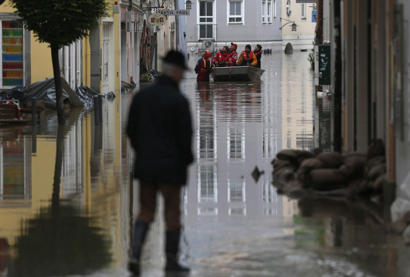 Red cross teams use boats to evacuate people after river Danube flooded the old town of Passau, southern Germany, on Tuesday, June 4, 2013. Raging waters from three rivers have flooded large parts of the southeast German city following days of heavy rainfall in central Europe. Floodwaters in Passau are receding from the highest level seen in more than five centuries but cities downstream are bracing themselves as swollen rivers sweep through southeastern Germany. At least eight people have been reported dead and nine missing in the floods in Germany, Austria, Switzerland and the Czech Republic. (AP Photo/Matthias Schrader)