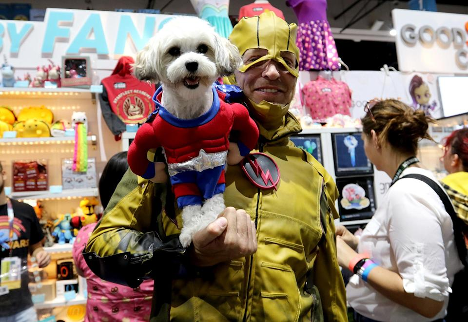 <p>Cosplayer dressed as the Flash from DC Comics and his superhero dog at Comic-Con International on July 21, 2018, in San Diego. (Photo: Angela Kim/Yahoo Entertainment) </p>