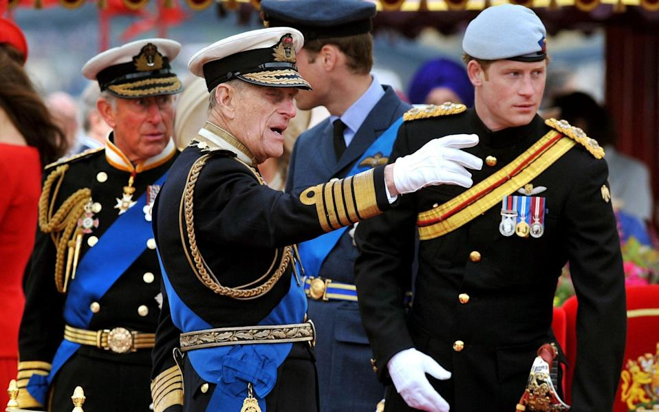 Prince Charles, Prince of Wales, Prince Philip, Duke of Edinburgh, Prince William and Prince Harry talk onboard the Spirit of Chartwell during the Thames Diamond Jubilee Pageant on the River Thames in London - AFP